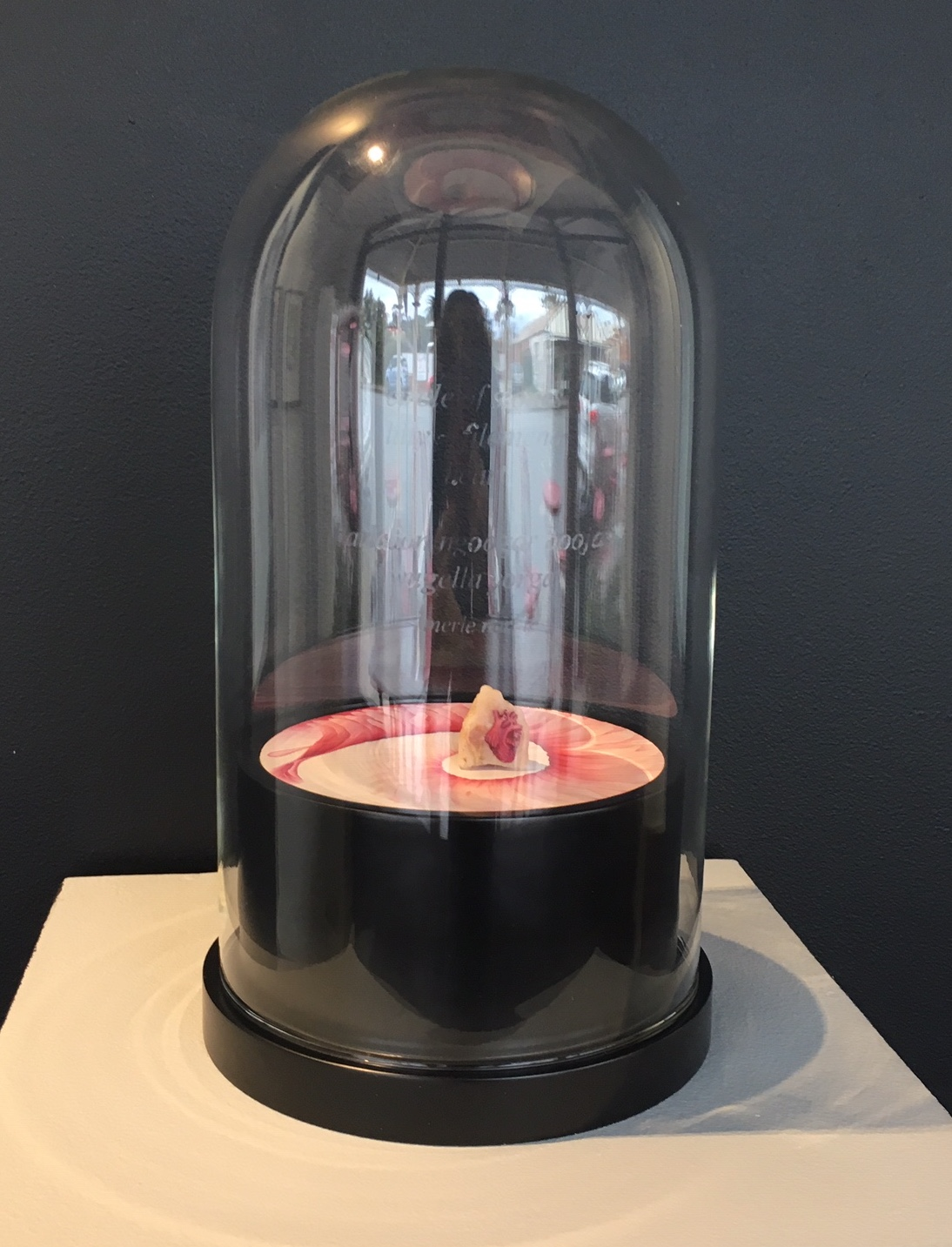 Installation View, Circle of Stones, Gallery 152, York, WA. circle of stones, lilly – filomena, heart. Rose quartz, gouache, colour photograph on dibond, wooden base and etched glass dome with text by Merle Narkle-Goodwin. 15d x 27h cm. 2017-18